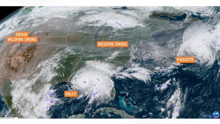 Satellite image shows wildfire smoke reaching the eastern US as hurricanes churn