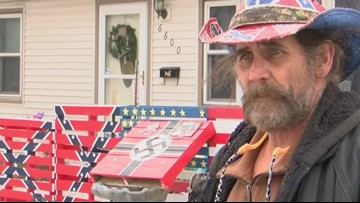Homeowner defends Confederate flag, Swastika paintings across from elementary school