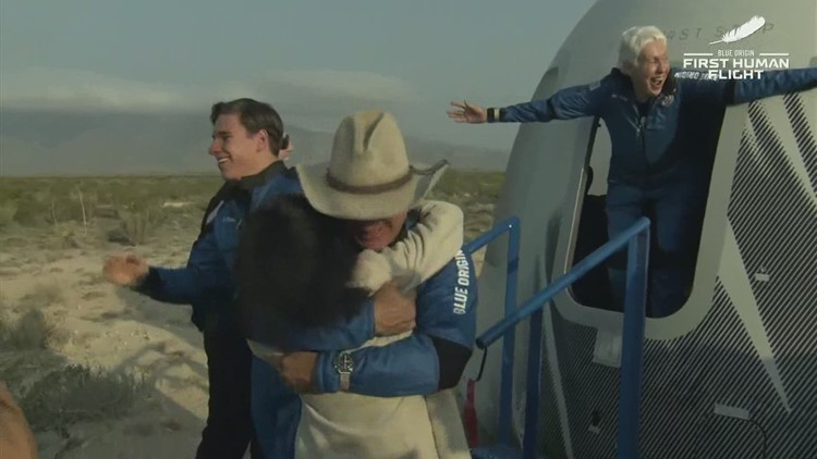 Jeff Bezos, Blue Origin crew emerge from capsule