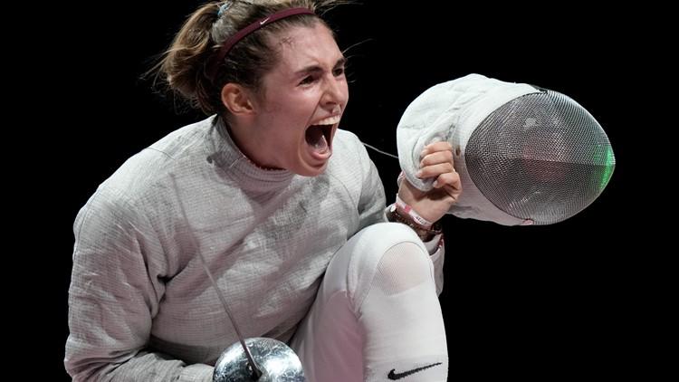 Fencer Pozdniakova wins Olympic gold in family tradition