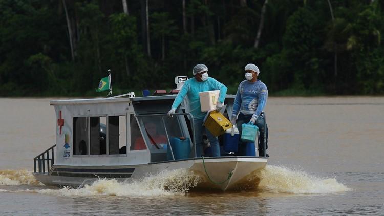 Boat, snowmobile, camel: COVID-19 vaccine reaches world's far corners
