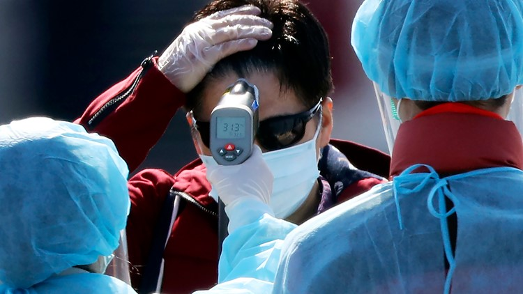 Japan Virus Crisis Diamond Princess temperature check AP