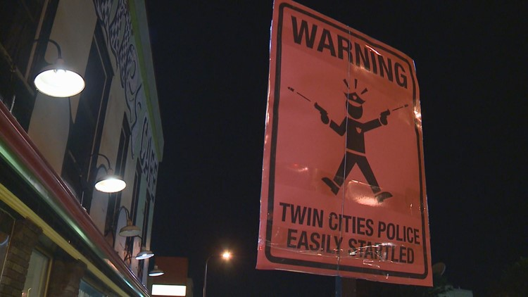 Mystery signs mock Mpls. Police