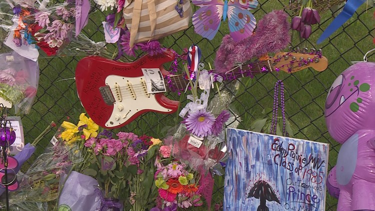 Fans continue to visit the growing memorial at Paisley Park. (Credit: KARE 11)