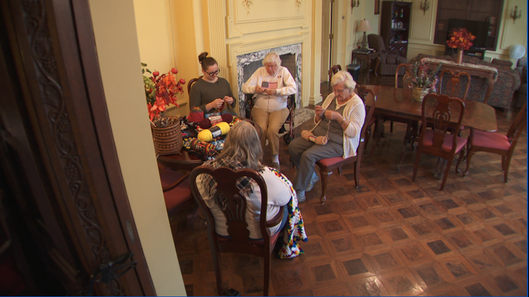 Winona State University student Laura Jensen hosts a crocheting circle for residents of Watkins assisted living home where she lives.