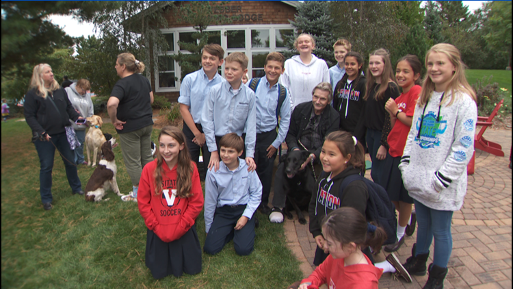 Last year's 5th-grade class at Visitation School poses with Jay Mitchell for a photo.