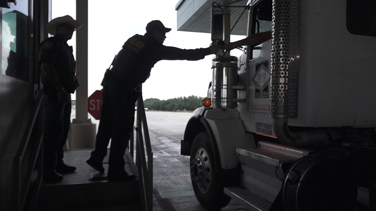 Border Patrol agent inspects a cargo truck at the Falfurrias checkpoint