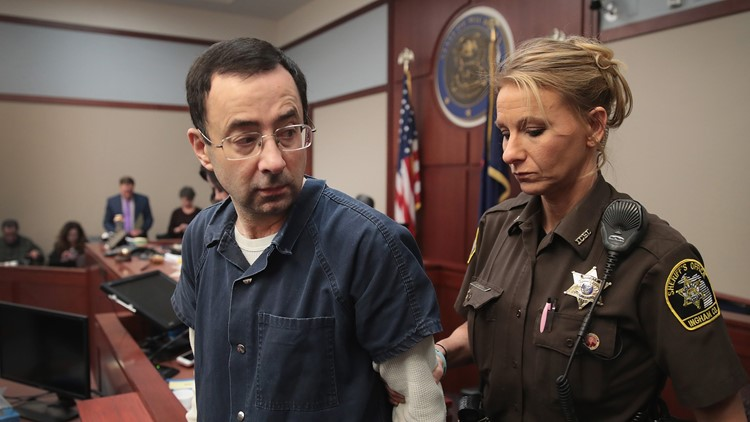 Larry Nassar appears in court to listen to victim statements prior to being sentenced after being accused of molesting about 100 girls while a physician for USA Gymnastics and Michigan State University on January 16, 2018 in Lansing, Michigan.