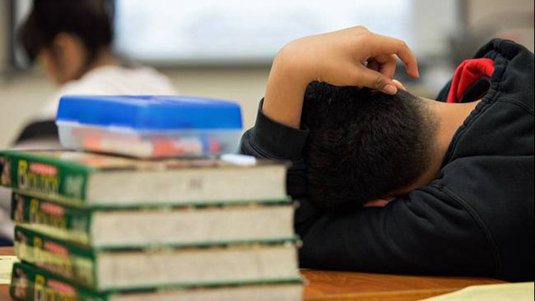 A student at the Elsik Ninth Grade Center rests during a lesson while participating in an after-school program.   Pu Ying Huang for The Texas Tribune