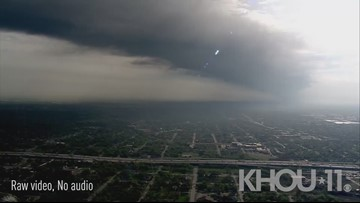 Raw: Smoke plume blowing into skies above N. Houston late Tuesday morning
