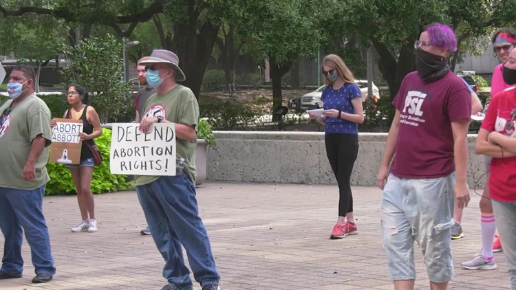 Women's rights activists protest Texas abortion law outside Houston City Hall