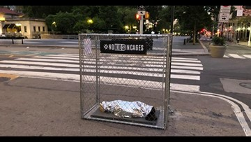 Art installations depicting crying children in cages pop up across New York City