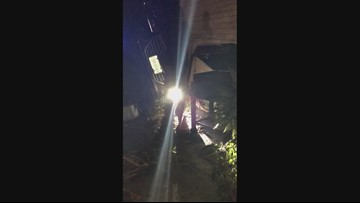 Cell phone video: Man flips car into apartment after being shot