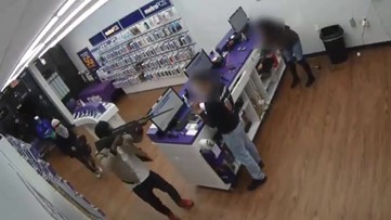 Raw Video: Robber strikes clerk in the face with rifle during violent robbery