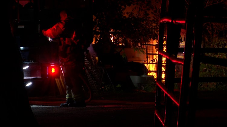 Houston police trying to ID woman who was found dead after travel trailer fire outside home