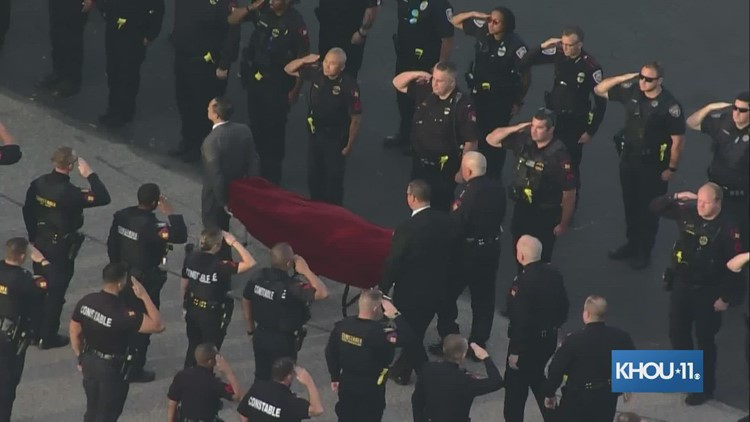 Body of slain deputy escorted to Tomball funeral home
