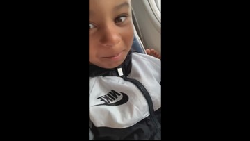 Young boy's hilarious reaction to foot behind him on Orlando to Houston flight