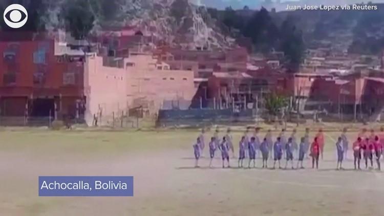 Dust devil interrupts soccer game in Bolivia