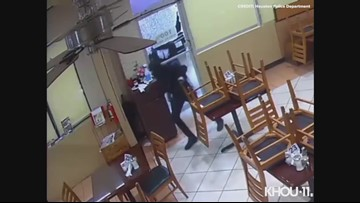 Raw Video: Eight armed robbery suspects storm Houston restaurant as it closes