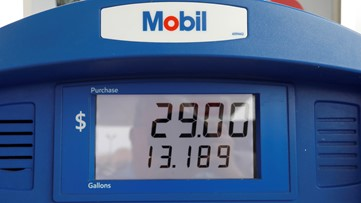Exxon Mobil profit falls 49% as oil and gas prices decline