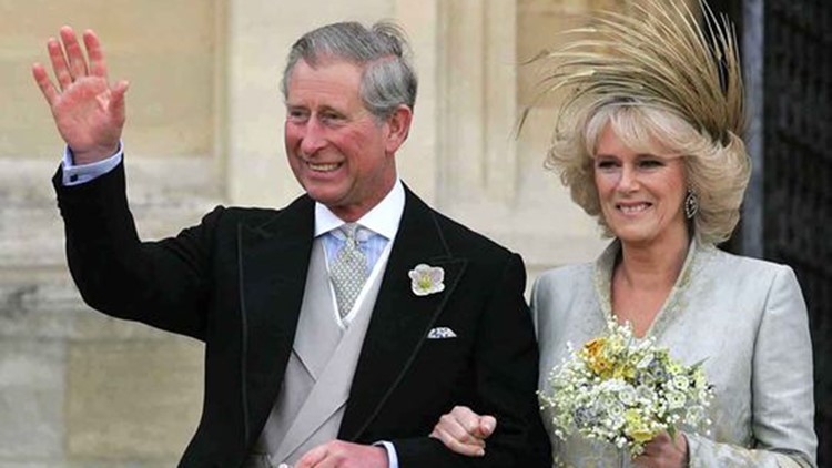 Prince Charles with his wife Camilla, Duchess of Cornwall following a Service of Prayer and Dedication at St. George's Chapel at Windsor Castle, Saturday, April 9, 2005. (Photo: Toby Melville/AP)