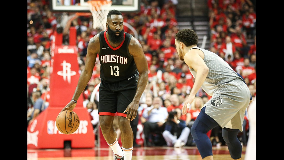 6ef127506efd Houston Rockets guard James Harden (13) dribbles the ball as Minnesota  Timberwolves guard Tyus Jones (1) defends during the third quarter in game  two of the ...
