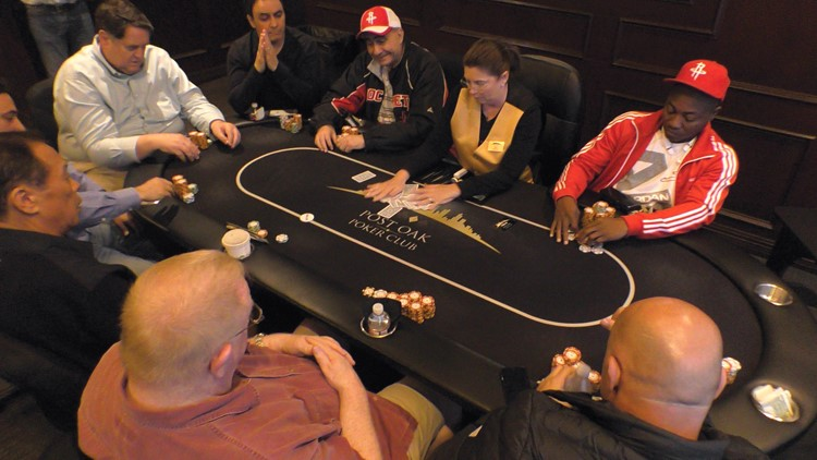 A dealer at Post Oak Poker Club shuffles cards after a hand of Texas Hold 'em.