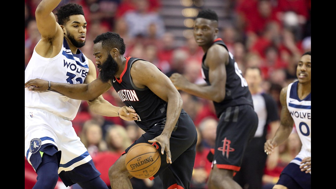 Houston Rockets guard James Harden (13) drives against Minnesota  Timberwolves center Karl-Anthony Towns (32) in game five of the first round  of the 2018 NBA ... e89c5ec73