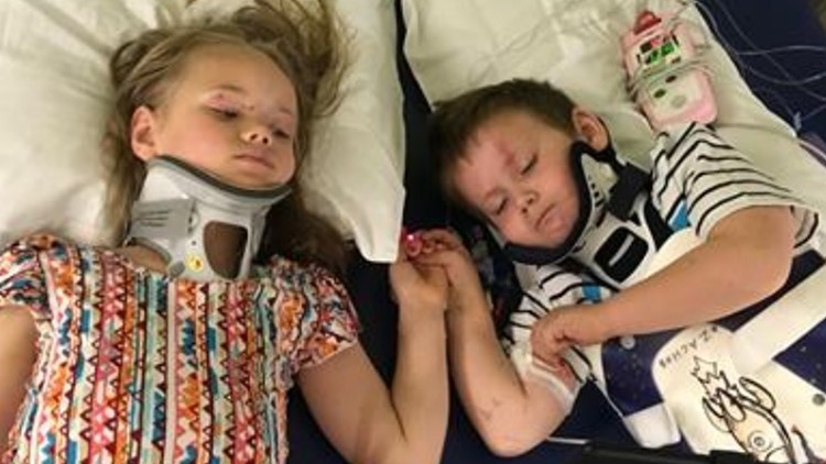 Incredible photo shows siblings reunited after auto crash that killed their parents
