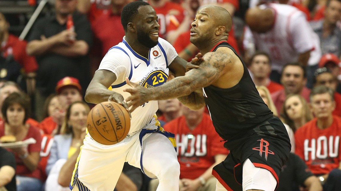 af81717b4cb Golden State Warriors forward Draymond Green dribbles the ball against  Houston Rockets forward PJ Tucker during the first quarter in game one of  the Western ...