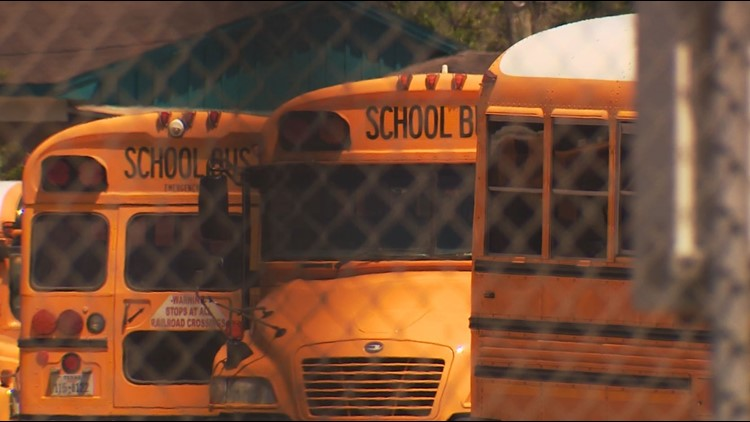 School buses sitting empty at an HISD bus barn.