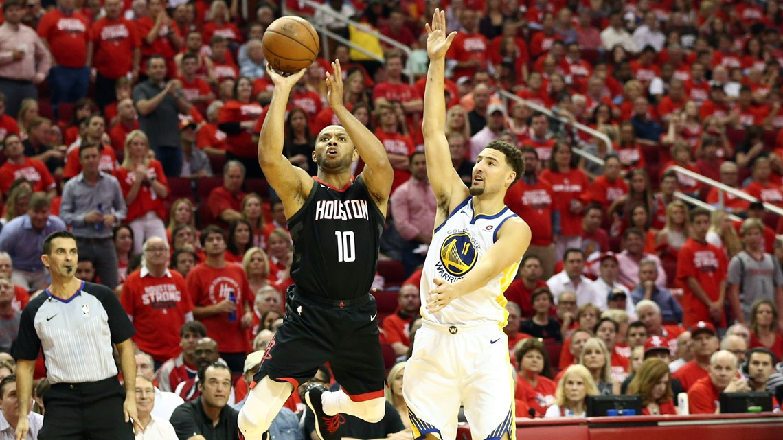 12986eddbaa9 Houston Rockets guard Eric Gordon (10) shoots over Golden State Warriors  guard Klay Thompson (11) during the second quarter in game five of the  Western ...