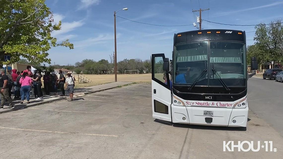 Haitian migrants prepare to board bus as they are processed in Del Rio