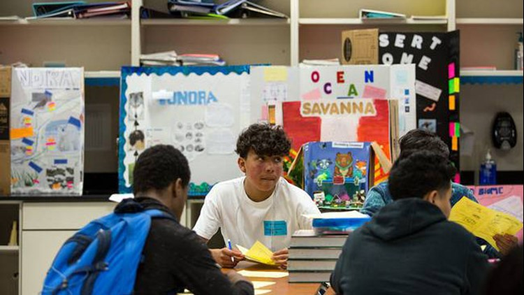 Daniel Saldana, a ninth-grade student at Elsik Ninth Grade Center, looks up during a quiz about biomolecules.   Pu Ying Huang for The Texas Tribune