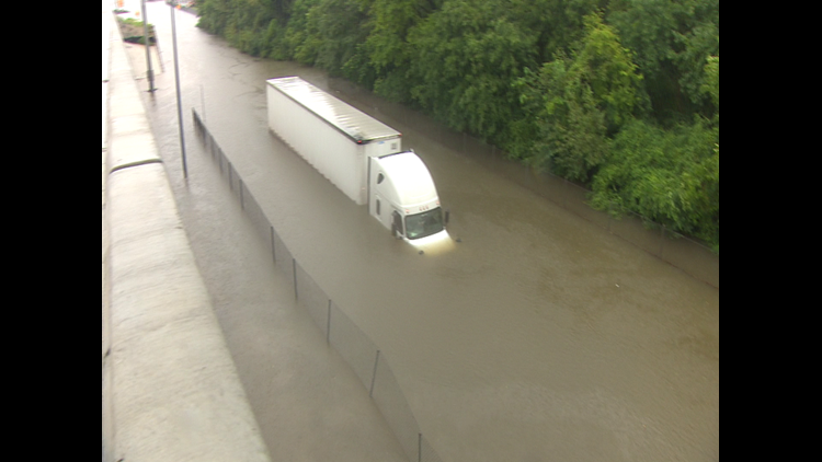"""Robert Roberson says he was following another truck on the North Sam Houston Tollway frontage road when """"the water hit me."""""""