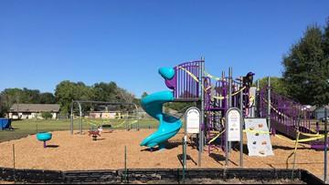 Volunteers help build school playground in just hours