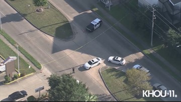 Raw Video: Officer shoots, kills armed suspect in front of elementary school in southwest Houston, police say