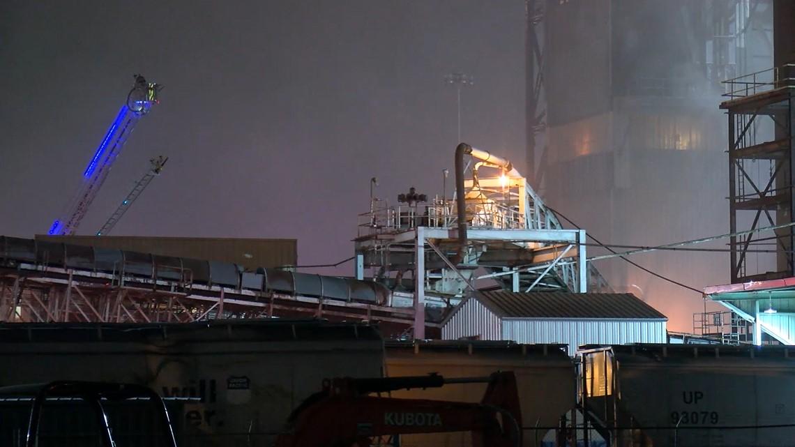 four firefighters suffer heat exhaustion battling grain