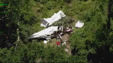 Raw video: Air 11 surveys plane crash site in Walker County