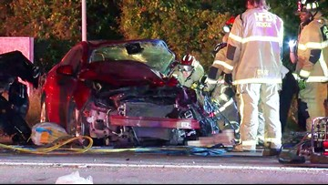 Woman pinned inside car after rollover crash involving SUV and big rig