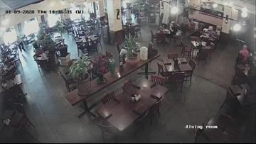 Raw video: Tire flies into restaurant, narrowly misses employee