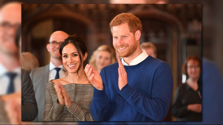 CARDIFF, WALES - JANUARY 18: Prince Harry and his fiancee Meghan Markle watch a performace during their visit to Cardiff Castle on January 18, 2018 in Cardiff, Wales.
