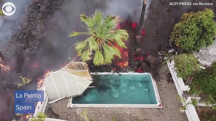 Lava pours into pool on La Palma island in Spain