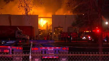 Large flames shoot from clothing recycling center in northeast Houston
