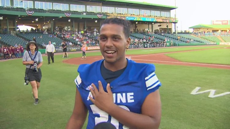 Aldine HS football hero throws first pitch at Skeeters game