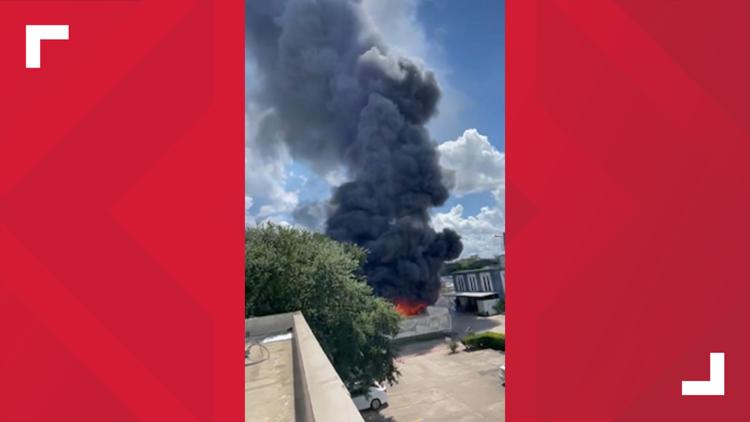 VIDEO: Dark plumes of smoke over burning business along Katy Freeway