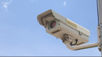 VERIFY: Unpaid red light camera tickets shouldn't impact registration