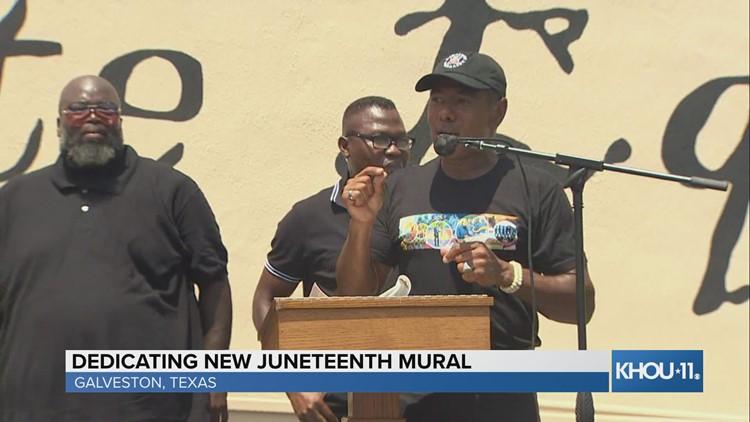 Mural artist Reginald Adams and his team The Creatives speak at dedication ceremony