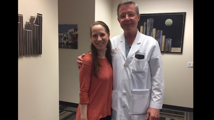 Dodson posing for a photo with her doctor at Memorial Hermann Hospital