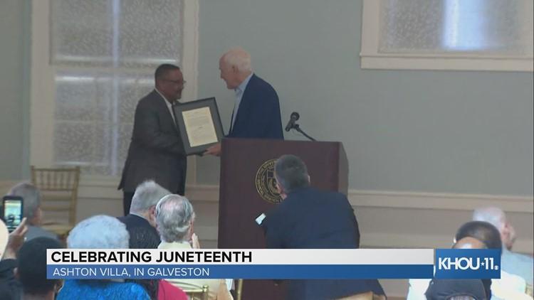 Sen. John Cornyn presents framed copy of SB 475 at Juneteenth celebration